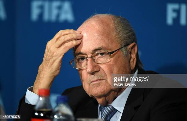 FIFA president Sepp Blatter looks on during a press conference on December 19 2014 in the Moroccan city of Marrakesh top US lawyer Michael Garcia...