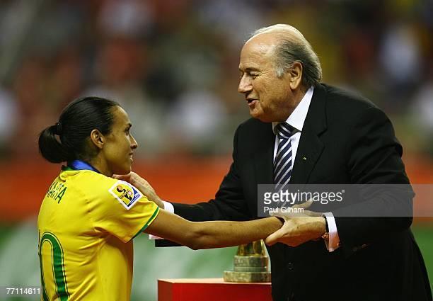 President Sepp Blatter presents Marta Vieira Da Silva of Brazil with her runners up medal during the Women's World Cup 2007 Final between Brazil and...
