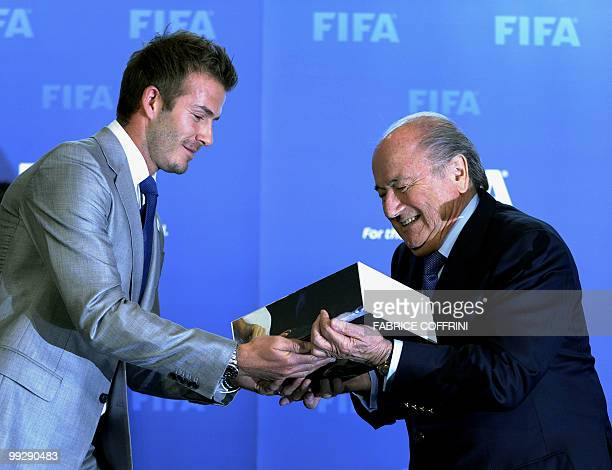 FIFA president Sepp Blatter receives from David Beckham the England 2018 and 2022 World Cup bid book during for an official handover ceremony at...