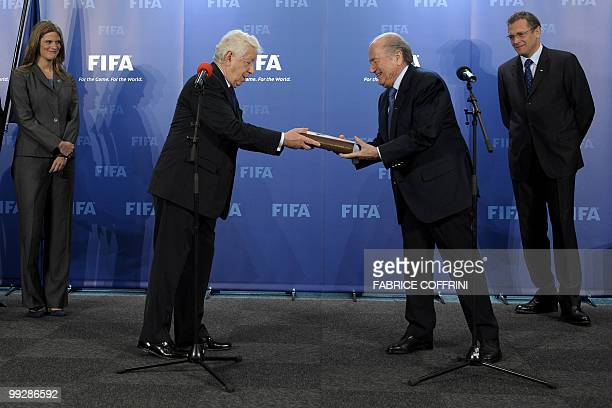 President Sepp Blatter receives from the hands of Football Federation Australia chairman Frank Lowy the bid books for 2018 and 2022 FIFA World Cups...