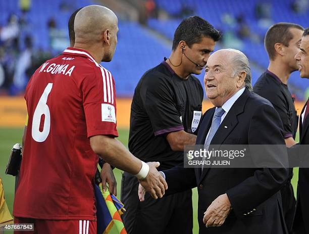 FIFA president Sepp Blatter shakes hands of CF Monterrey's Mexican defender Efrain Juarez before the Mexican team's match against Egypt's AlAhly at...