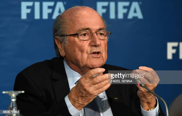 FIFA president Sepp Blatter speaks during a press conference on December 19 2014 in the Moroccan city of Marrakesh top US lawyer Michael Garcia...