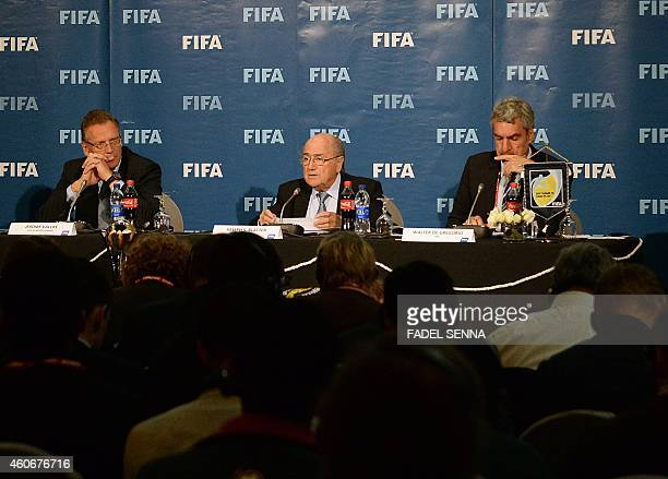 FIFA president Sepp Blatter speaks next to FIFA Secretary General Jerome Valcke and Director of Communications Walter De Gregorio during a press...