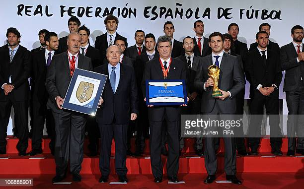 President Sepp Blatter stands with the Spanish Head coach Vicente del Bosque the President of the Spanish Football Federation Angel Maria Villar and...
