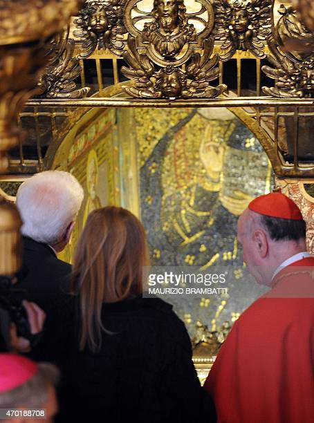 President Sergio Mattarella and his daughter Laura flanked by Cardinal Angelo Comastri look at the St Peter's tomb in St Peter's basilica during a...