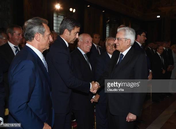 President Sergio Mattarella greets Alessandro Costacurta during Italy Team meets President Sergio Mattarella on October 15 2018 in Rome Italy