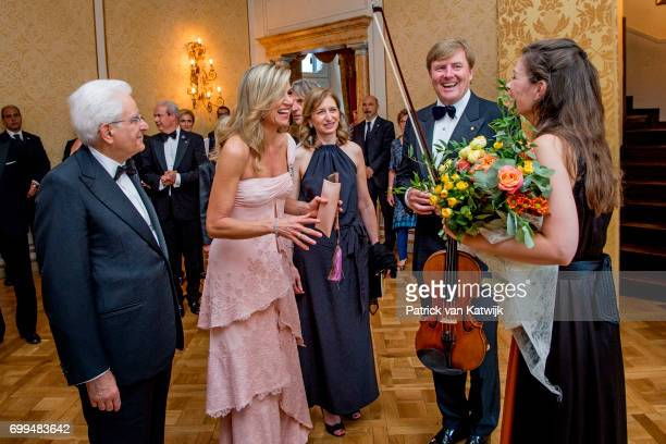 President Sergio Mattarella Queen Maxima of The Netherlands and King WillemAlexander of The Netherlands attend a concert performed by Dutch violinist...