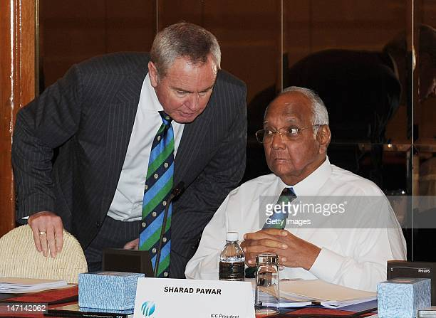 President Sharad Pawar talks to ICC Vice President Alan Isaac during the ICC Executive Board meeting convened during the ICC Annual Conference held...