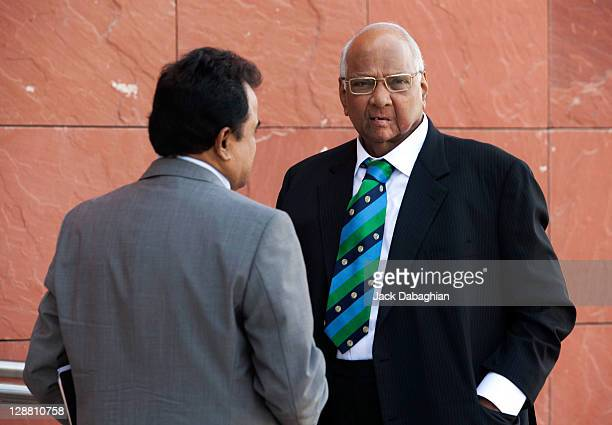 President Sharad Pawar talks with Mustafa Kamal prior to the ICC Executive Board meeting at the International Cricket Council headquarters on October...