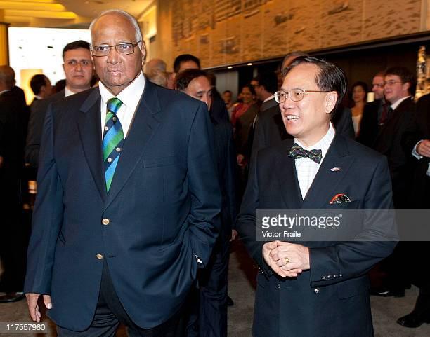 President Sharad Pawar walks with Hong Kong Chief Executive Donald Tsang during the 2011 ICC Annual Conference at Hong Kong Club on June 27 2011 in...