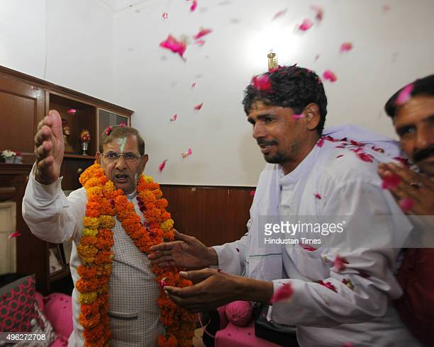 JD President Sharad Yadav celebrates after Mahagathbandhan's victory in Bihar assembly elections on November 8 2015 in New Delhi India Nitish Kumar...
