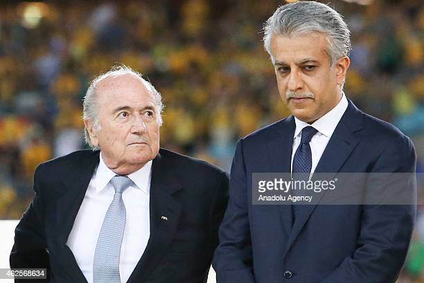 AFC president Sheikh Salman Bin Ibrahim AlKhalifa and FIFA president Sepp Blatter are seen during the trophy presentation after the 2015 Asia Cup...
