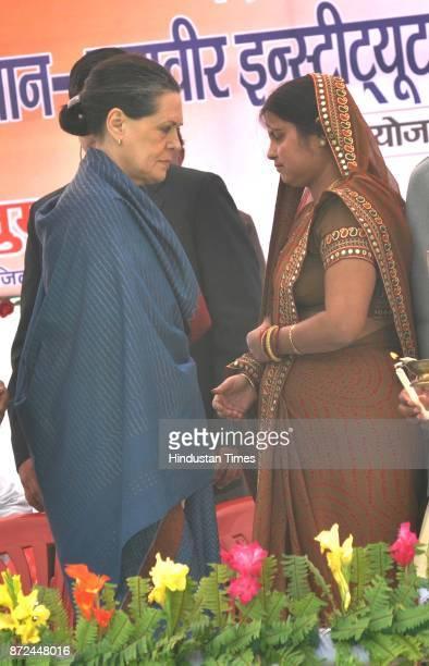 UPA president Sonia Gandhi speaks to Suman Singh presidet of Zila Panchayat Raebareliduring the Panchayat Pratinidhi Sammelan at Mahaveer Institute...
