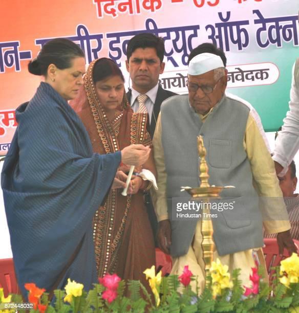 UPA president Sonia Gandhi speaks to Suman Singh presidet of Zila Panchayat Raebareli during the Panchayat Pratinidhi Sammelan at Mahaveer Institute...