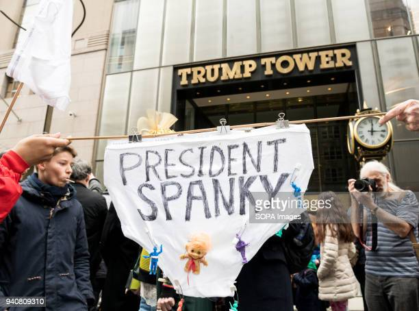 'President Spanky' sign at 'Trumps Grand Military Parade' was the theme of New York City's 33rd Annual Aprils Fools Day Parade and 2nd Annual...