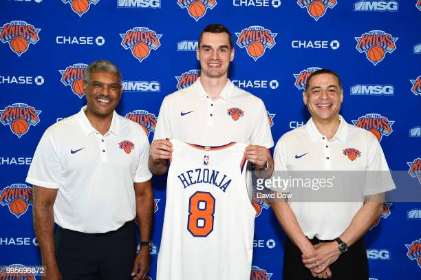 President Steve Mills Mario Hezonja and General Manager Scott Perry of the New York Knicks poses for a photo announcing Mario's signing on July 10...