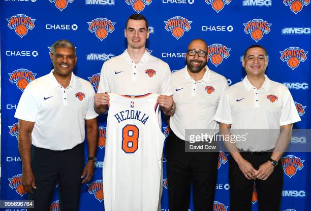 President Steve Mills Mario Hezonja Head Coach David Fizdale and General Manager Scott Perry of the New York Knicks poses for a photo announcing...