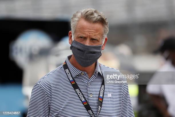 President Steve Phelps walks the grid prior to the NASCAR Cup Series The Real Heroes 400 at Darlington Raceway on May 17, 2020 in Darlington, South...