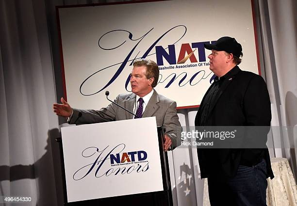 President Steve Tolman presents honoree and CEO/President of Webster PR Kirt Webster with an award onstage during the NATD Honors Gala on November 9...