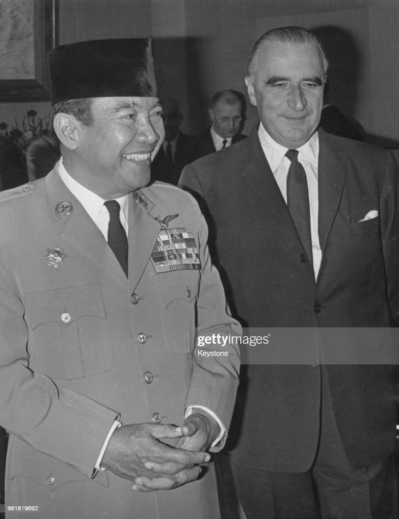 President Sukarno of Indonesia (1901 - 1970, left) is received by French President Georges Pompidou (1911 - 1974, right) during a three-day unofficial visit to Paris, France, 20th October 1964.