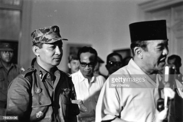 President Sukarno of Indonesia walks with the Major General Suharto March 11 1966 in Idonesia Sukarno was obliged by the Indonesia Army to give Major...