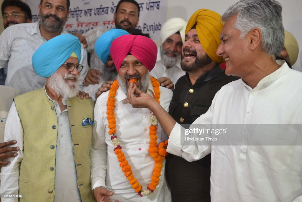 PPCC president Sunil Jakhar local bodies minister Navjot Singh Sidhu former cabinet minister Rana Gurjit Singh offering sweets to congress candidate..