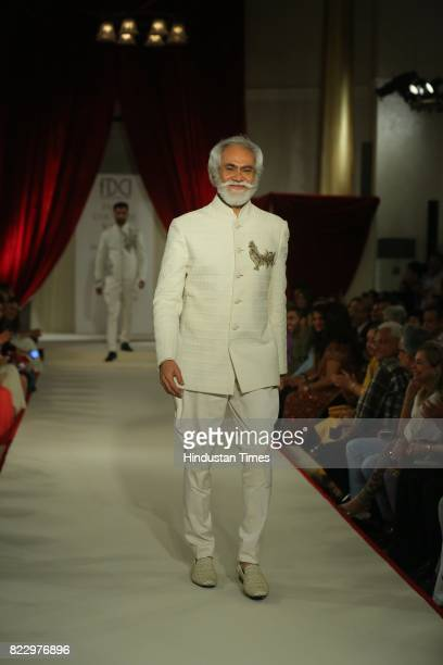 President Sunil Sethi showcasing the couture collection of designer Rohit Bal during the first day of India Couture Week 2017 on July 24 2017 in New...