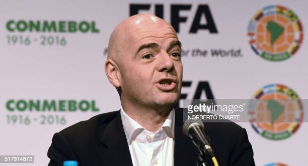 President Swiss Gianni Infantino gestures as he delivers a press conference at the Conmebol headquarters in Luque Paraguay on March 28 2016 Infantino...