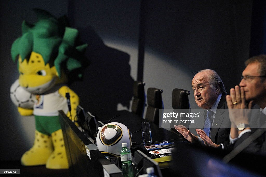 FIFA president Swiss Sepp Blatter gestures beside FIFA Seneral Secretary frenchman Jerome Valcke (Far R) with Zakumi, the FIFA 2010 World Cup mascot as background during a press conference on April 23, 2010 at the football's governing body headquarters in Zurich, 48 days before the beginning of the football tournament hosted by South Africa from June 11 to Jully 11, 2010.