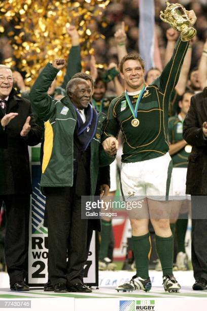 President Thabo Mbeki and John Smit with the trophy during the IRB 2007 Rugby World Cup final match between South Africa and England held at the...