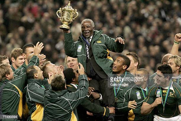 President Thabo Mbeki hold the trophy and celebrates with the Springbok team during the IRB 2007 Rugby World Cup final match between South Africa and...