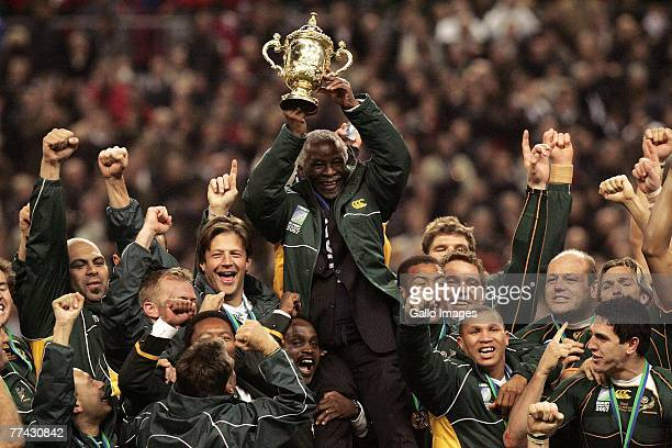 President Thabo Mbeki holds the trophy and celebrates with the South African team after the IRB 2007 Rugby World Cup final match between South Africa...