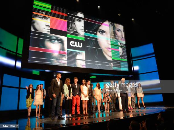 President The CW Television Network Mark Pedowitz and the CW's allstar cast on stage at the CW Network's 2012 Upfront at New York City Center on May...