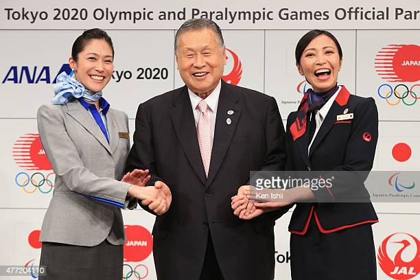 President The Tokyo Organizing Committee of the Olympic and Paralympic Games Yoshiro Mori poses for photographers with flight attendants during the...