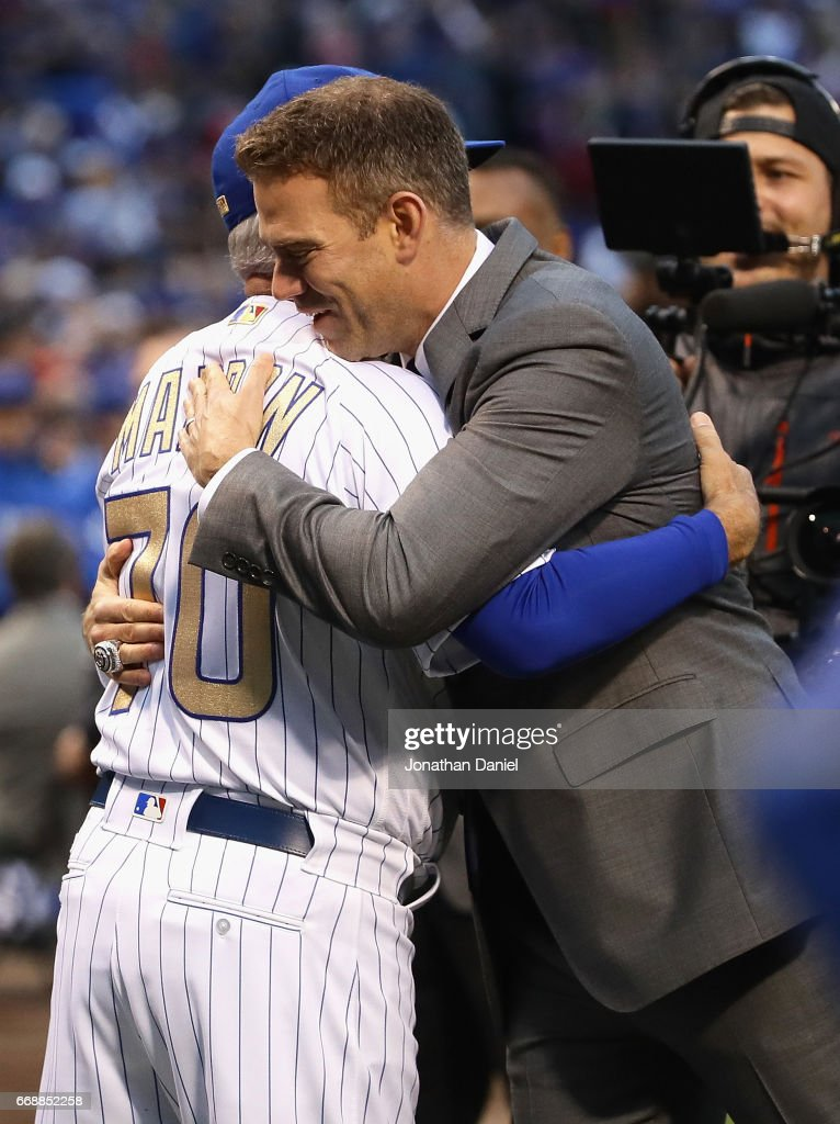 President Theo Epstein of the Chicago Cubs hugs manager Joe Madden #70 during a ring ceremony before a game against the Los Angeles Dodgers at Wrigley Field on April 12, 2017 in Chicago, Illinois.