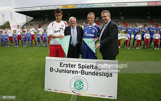 President Theo Zwanziger of the German Football Association and Peter Freymuth pose with team captains Thomas Denker of Essen and JanNiklas Temme of...