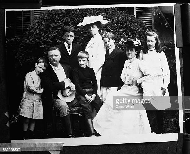 President Theodore Roosevelt poses for a family portrait with his wife Edith daughters Alice and Ethel and sons Theodore Jr Kermit Archibald and...
