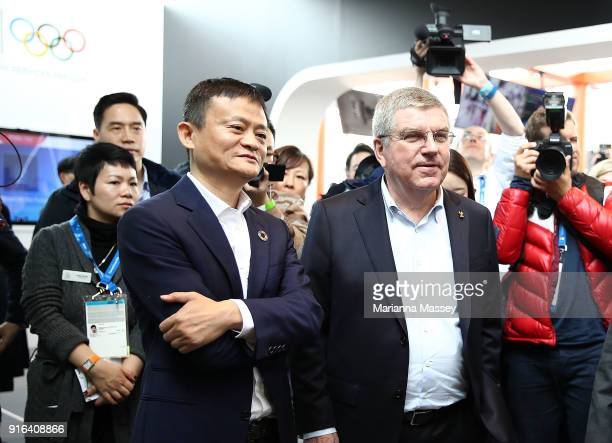 President Thomas Bach and Alibaba Group Executive Chairman Jack Ma tour the Alibaba Showcase at the PyeongChang 2018 Winter Olympic Games on February...