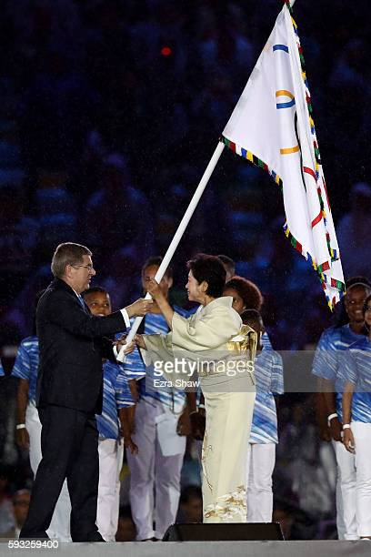 President Thomas Bach and Governor of Tokyo Yuriko Koike take part in the Flag Handover Ceremony during the Closing Ceremony on Day 16 of the Rio...