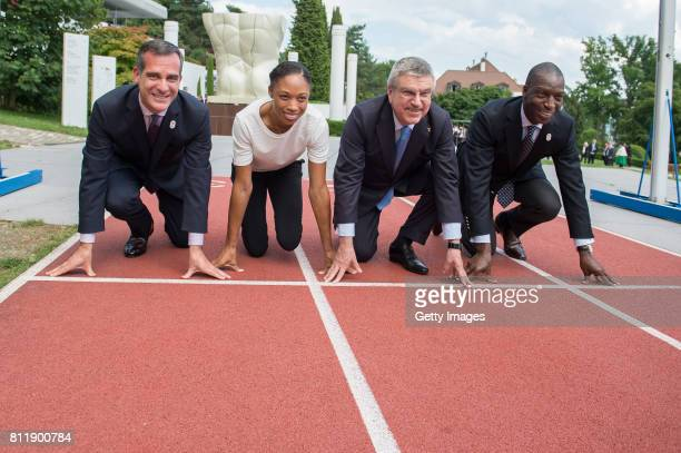 President Thomas Bach and Mayor of Los Angeles Eric Garcetti with USA Olympic medalists Allyson Felix and Michael Johnson at the start of the Olympic...