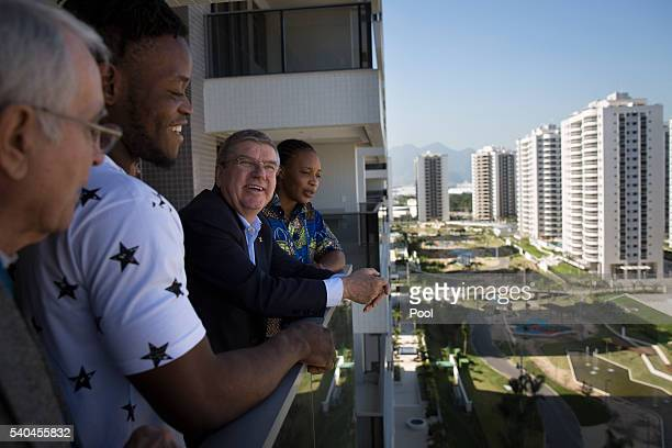 President Thomas Bach, center, talks with refugees and judo athletes from the Democratic Republic of Congo Yolande Mabika, right, and Popole Misenga...