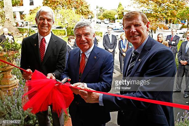 President Thomas Bach cuts the ribbon to officially open Olympic House with NZOC President Mike Stanley and IOC member Barry Maister on May 5 2015 in...