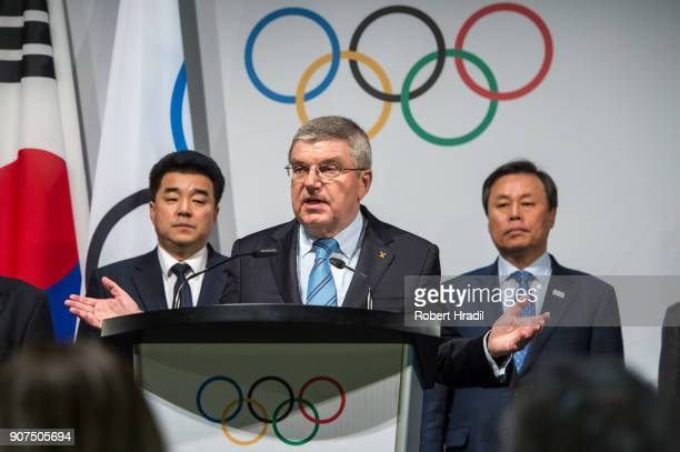 President Thomas Bach gives a speech behind him representatives of both countries on left Mr Il Guk Kim Sport Minister and President of the Olympic...