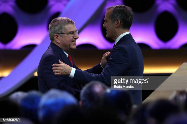 President Thomas Bach greets Los Angeles Mayor Eric Garcetti during the 131th IOC Session 2024 2028 Olympics Hosts Announcement at Lima Convention...