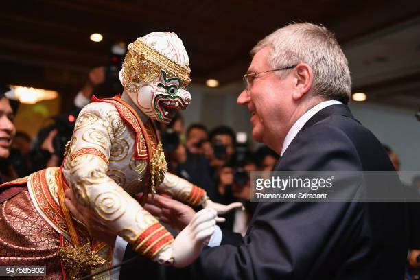 President Thomas Bach is greeted by a Thai traditional puppet prior to the SportAccord Opening Ceremony at the Royal Thai Navy Convention Hall on...