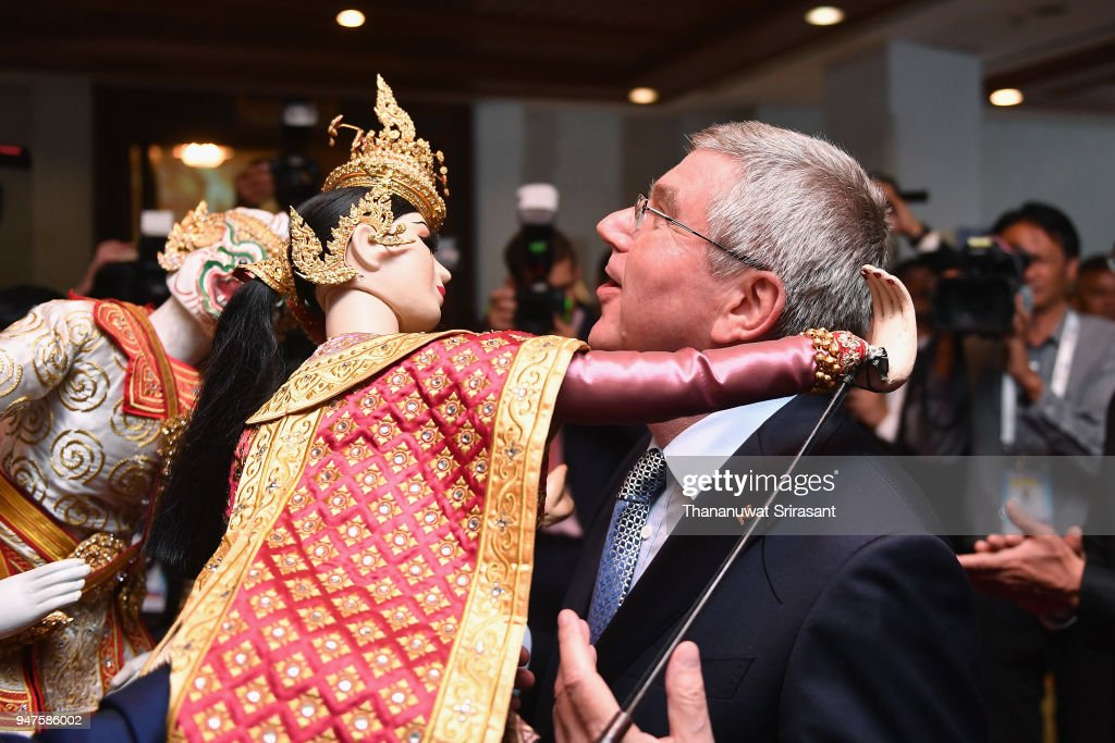 President Thomas Bach is hugged by a Thai traditional puppet prior to the SportAccord Opening Ceremony at the Royal Thai Navy Convention Hall on April 17, 2018 in Bangkok, Thailand.