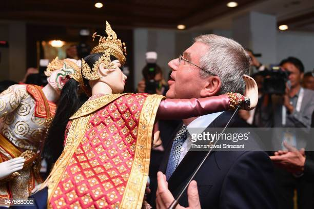 President Thomas Bach is hugged by a Thai traditional puppet prior to the SportAccord Opening Ceremony at the Royal Thai Navy Convention Hall on...