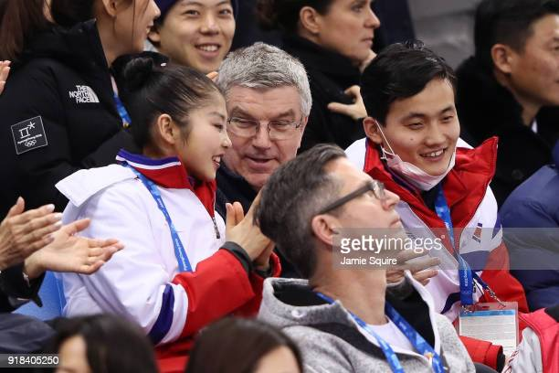 President Thomas Bach looks on with Tae Ok Ryom and Ju Sik Kim of North Korea during the Pair Skating Free Skating at Gangneung Ice Arena on February...