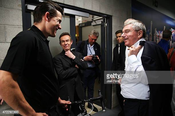 President Thomas Bach meets track cyclist Sam Webster during a visit to the Avantidrome on May 6 2015 in Cambridge New Zealand