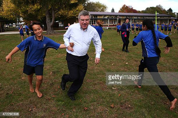 President Thomas Bach plays sports with students during a visit to Leamington Primary School on May 6 2015 in Cambridge New Zealand